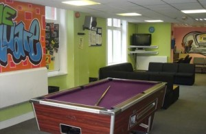 Photo of a pool table in the Square Youth Cafe