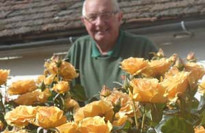 Hailsham Town Council's amenity warden Len Davies with the roses he has grown