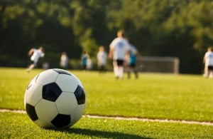 Photo of football and pitch