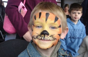 Photo of a child with tiger face paint