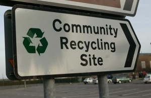 Photo of a recycling road sign