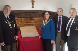 Photo of the Mayor and localcouncillors viewing the Victoria Cross paving stone