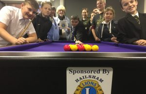Hailsham Lions' Geraldine Gurr and Gerry Constable with young people from the Square Youth Cafe