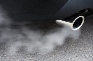 Car exhaust pipe fumes