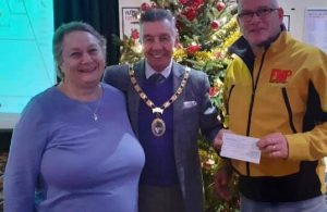 Town Mayor Cllr Paul Holbrook with Hailsham Bonfire Society's Rose Piggott and Youth Project Coordinator Andy Joyes